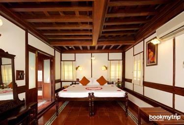 Bookmytripholidays | Travancore Heritage,Kovalam  | Best Accommodation packages